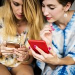 Young Women on Cellphones